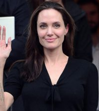 Hollywood star and UN refugee agency envoy Angelina Jolie gestures as she leaves the Greek Prime minister's office in Athens following a meeting with Greek Prime minister on March 16, 2016.   / AFP / LOUISA GOULIAMAKI        (Photo credit should read LOUISA GOULIAMAKI/AFP/Getty Images)